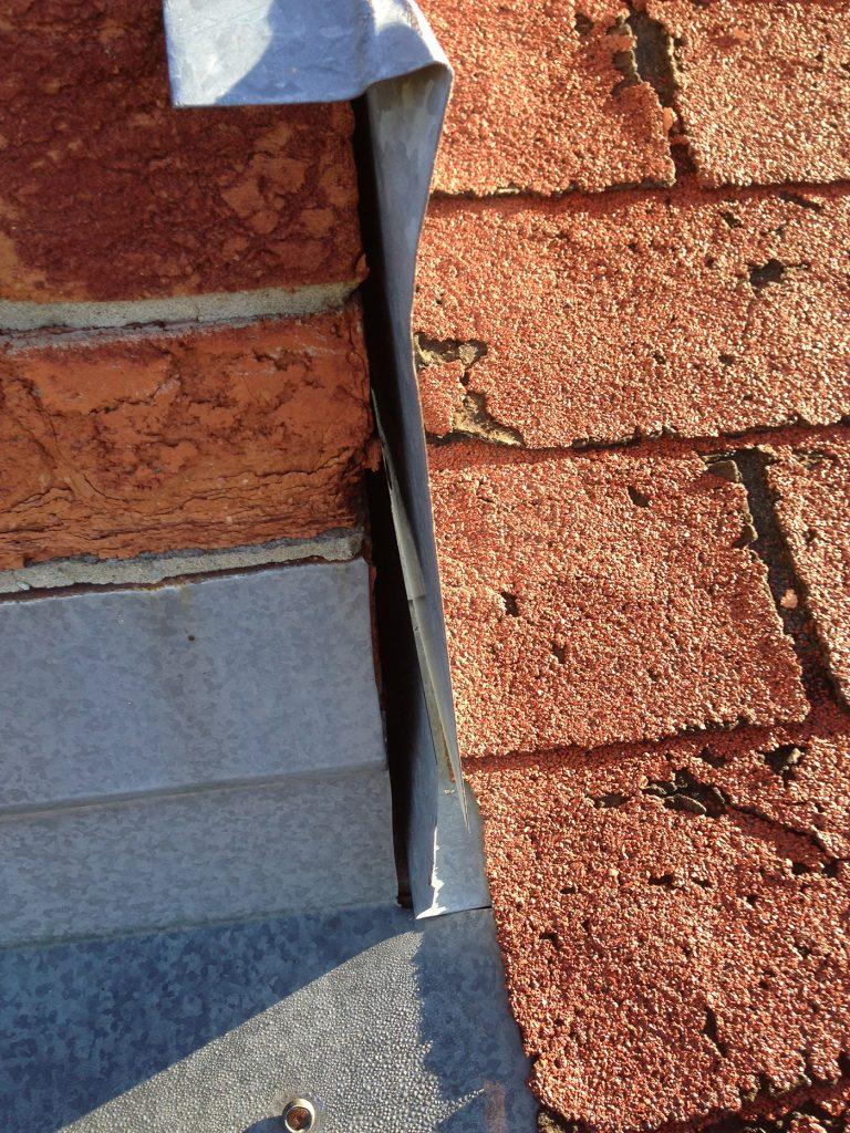 damaged shingles and improperly sealed flashing