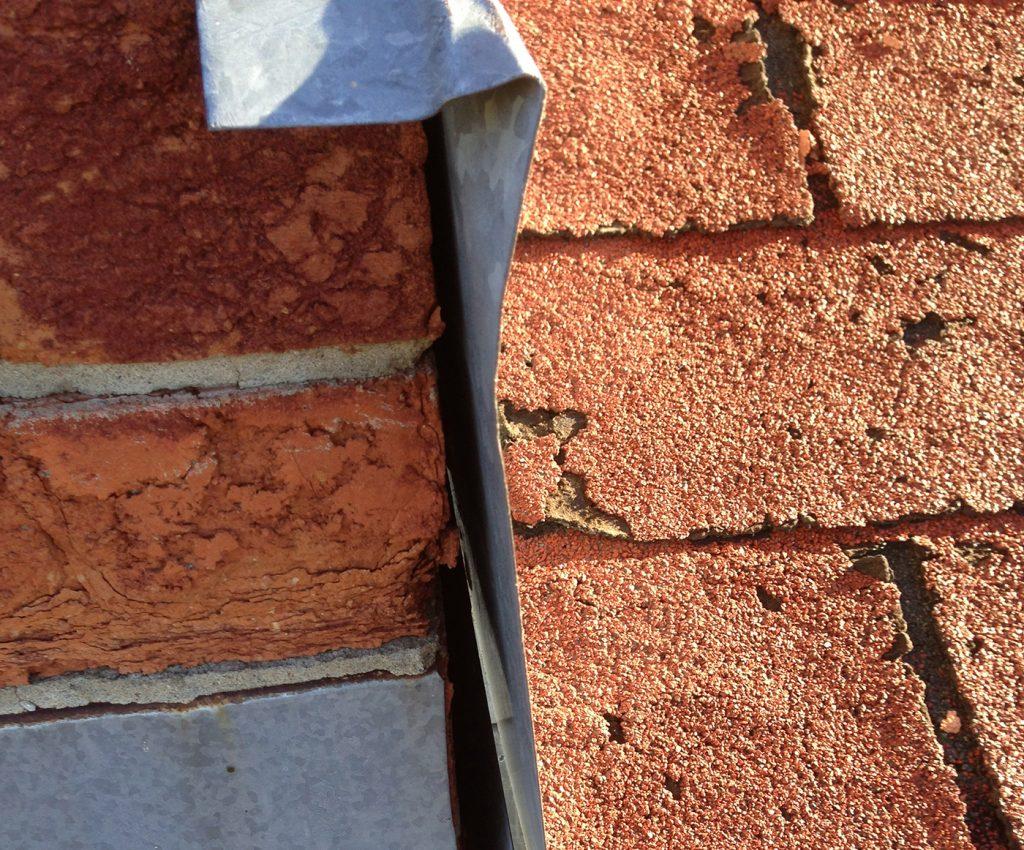 Damaged shingles & improperly sealed flashing